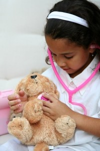 girl playing with stuffed animal
