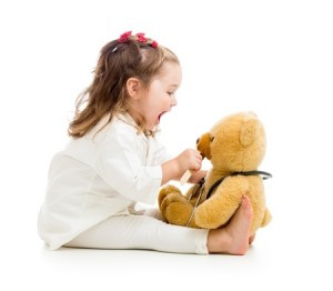 child with stuffed animal