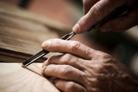 Woodworker Carving a Piece of Wood