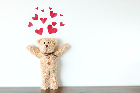 Teddy Bear with Hearts above it.