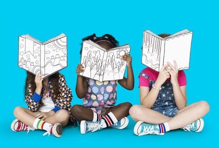 3 Children Reading