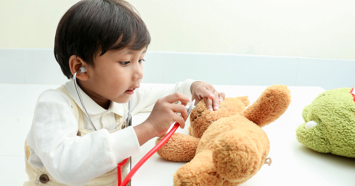 Playing Doctor with Stuffed Animal