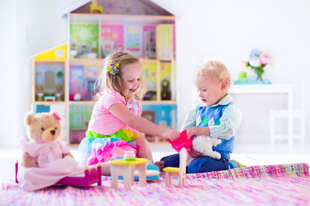 Kids playing with Doll House and Stuffed animal