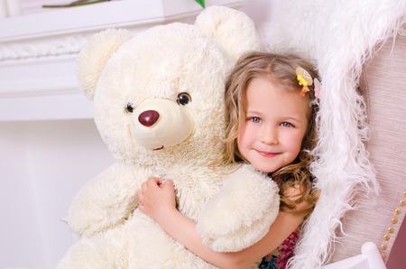 Girl Hugging white Teddy Bear