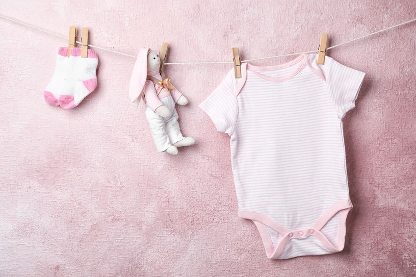 baby clothes hanging on wire
