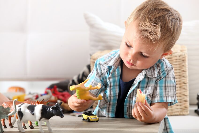 child playing with toys in living room